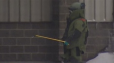 Members of the bomb squad were called out after the device was found inside the burned business on Marion in Winnipeg.