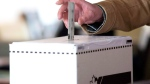 Casting a ballot. (Chris Young / THE CANADIAN PRESS)