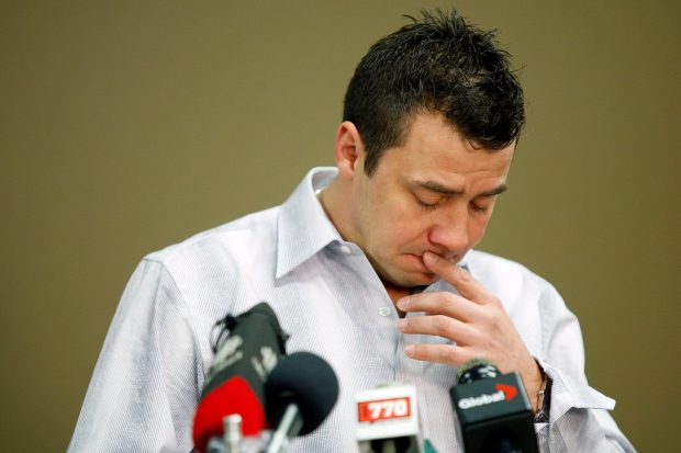 Sexual abuse victim, Todd Holt, holds back his emotions as he speaks to the media about the sentencing of his former hockey coach, Graham James, at a news conference held in Cochrane, Alta., Tuesday, March 20, 2012. (Jeff McIntosh / THE CANADIAN PRESS)