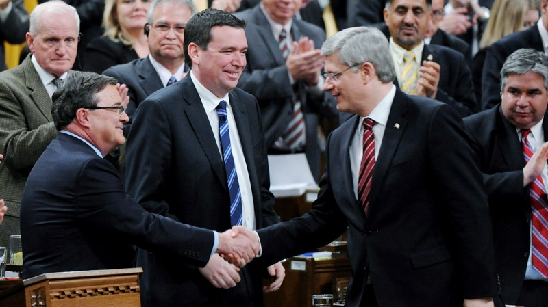 Prime Minister Stephen Harper shakes hands with Minister of Finance Jim Flaherty after delivering the Budget in the House of Commons on Parliament Hill in Ottawa on Thursday, March 29, 2012. (Sean Kilpatrick / THE CANADIAN PRESS)