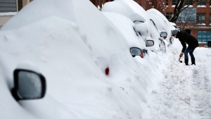Jill Leach shovels her car out at her home in Boston's Charlestown section, Wednesday, Jan. 28, 2015. (AP / Elise Amendola)