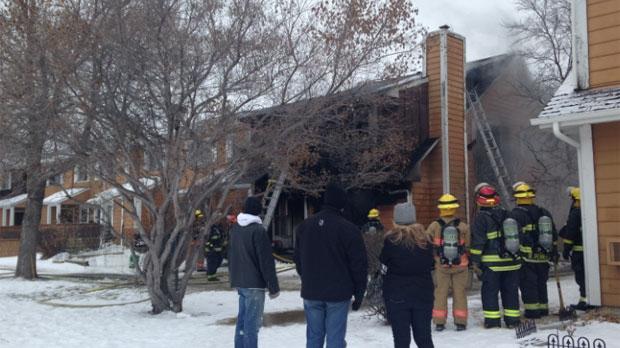 Firefighters battle the blaze in the 1700 block of St. Mary's Road in Winnipeg on Jan. 30, 2015.