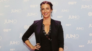 Alanis Morissette poses on the red carpet during the 2015 Juno Awards in Hamilton, Ont., on Sunday, March 15, 2015. (Peter Power /The Canadian Press)