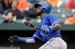 Blue Jays' Jose Reyes watches his sacrifice fly ball in the ninth inning of a home opener baseball game against the Baltimore Orioles in Baltimore on April 10, 2015. (Patrick Semansky/The Canadian Press/AP)