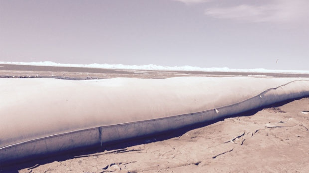 Inflatable tube dams have been used at Delta Beach to protect properties from ice ridges blowing in due to high winds.