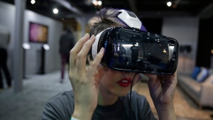 A woman demonstrates the Oculus virtual reality headset at the Facebook F8 Developers Conference in San Francisco on March 26, 2015. (AP / Eric Risberg)