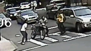 Surveillance video captured two men assault the dr