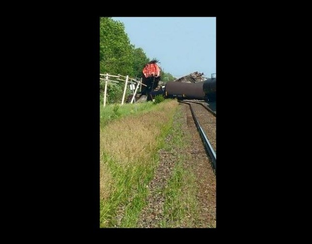 Homes evacuated after train jumps tracks