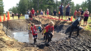 Around four thousand people slid, jumped and crawled through the mud near Grand Beach on Saturday.
