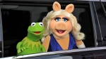 """Kermit the Frog, left, and Miss Piggy arrive at the World Premiere of """"Muppets Most Wanted,"""" in Los Angeles, on Tuesday, March 11, 2014. (Photo by Richard Shotwell/Invision/AP)"""