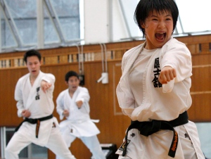 In this July 16, 2015 photo, Misaki Oku, right, a member of Japan's national team, practices karate with her teammates at Kokushikan University in Tokyo. (AP / Ken Aragaki)