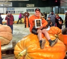 A 13-year-old Winnipeg boy has won the top prize for the largest pumpkin at the Roland Pumpkin Fair.