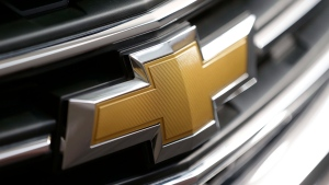 This Photo taken Feb. 14, 2013 shows a Chevrolet logo on the grill of a 2013 Traverse at the 2013 Pittsburgh Auto Show in Pittsburgh. General Motors is telling owners of some SUVs not to use their windshield wipers because an electrical short could cause the wiper motor to catch fire. (AP Photo/Gene J. Puskar, File)