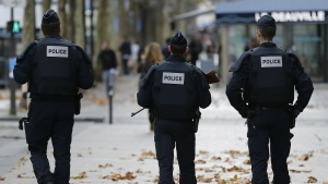 Police forces patrol on the Champs Elysee in Paris on Tuesday, Nov. 17, 2015. (AP / Frank Augstein)