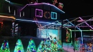 Michael Geiger-Wolf's annual display of Christmas lights on his home at 18 Mildred Street raises money for cancer research.