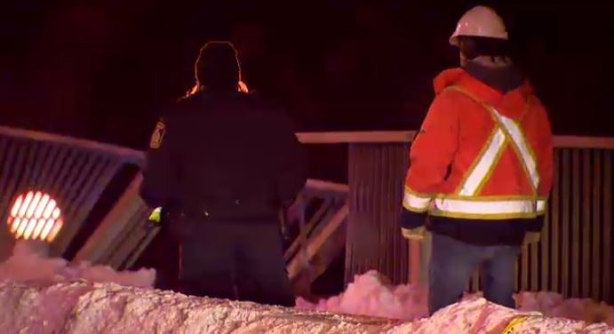 Crews inspect a damaged guard rail on the Moray Bridge Tuesday evening. A truck hit the railing.