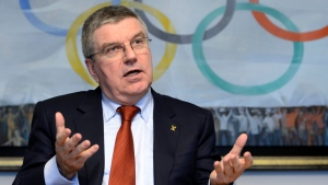 This is a Monday, Dec. 7, 2015, file photo of International Olympic Committee, IOC, president German Thomas Bach as he speaks during a media round table on the eve of an executive board meeting at the IOC headquarters, in Lausanne, Switzerland. (Laurent Gillieron/Keystone, File via AP)