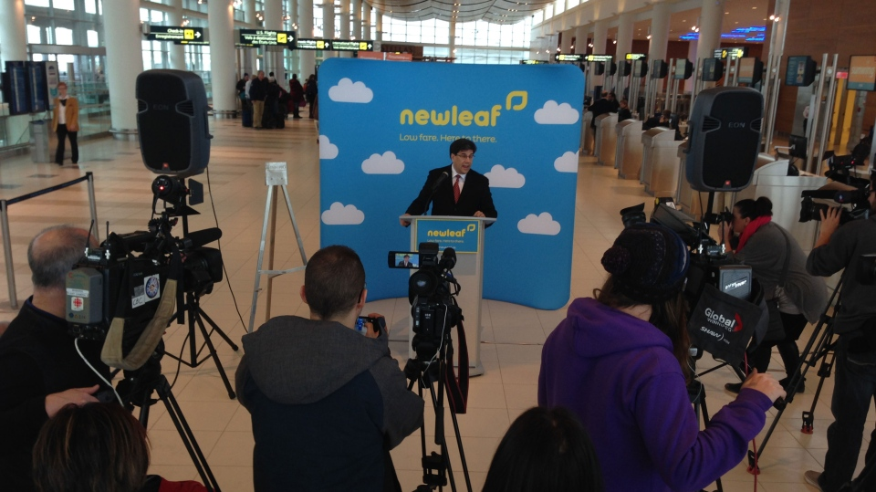 Jim Young, president and CEO of New Leaf Travel Company, addresses media at James Richardson International Airport on Jan. 6, 2016.
