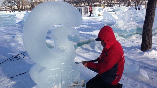 One of 40 ice sculptors from China works on a creation at The Forks. The artists have already carved out beautiful sculptures of animals, igloos and buildings.