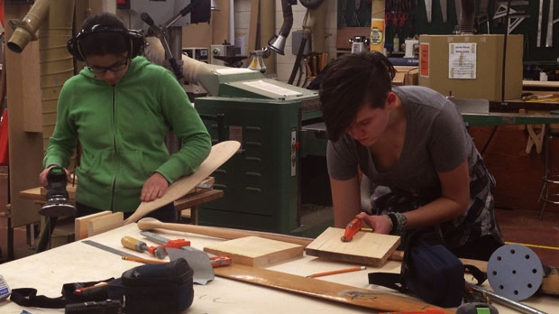 Teens learn how to make paddles from hand, and the history of canoeing in Canada.