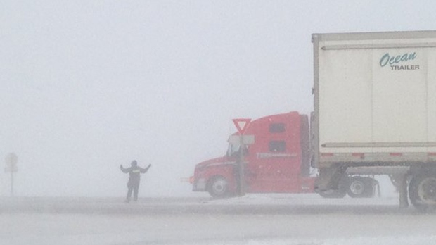 An RCMP officer forced trucks waiting westbound on Highway 1 to turn back east on Sunday, Feb. 7, 2016.