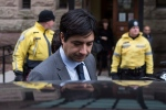 Former CBC radio host Jian Ghomeshi leaves a Toronto court after day four of his trial on Friday, February 5, 2016. THE CANADIAN PRESS/Chris Young