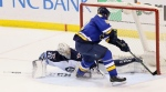 Winnipeg Jets goaltender Connor Hellebuyck makes a leg save on a shot by St. Louis Blues right wing Vladimir Tarasenko in a shootout.