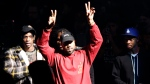 """Kanye West gestures to the audience at the unveiling of the Yeezy collection and album release for his latest album, """"The Life of Pablo,"""" Thursday, Feb. 11, 2016 at Madison Square Garden in New York. (AP Photo / Bruce Barton)"""