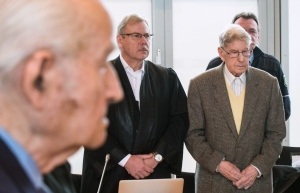 94-year-old former SS guard at the Auschwitz death camp Reinhold Hanning, right, stands next to his lawyer Andreas Scharmer, center, during his trial in Detmold, Germany, Friday, Feb. 12, 2016. (Bernd Thissen/Pool Photo via AP)