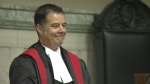 Kael McKenzie smiles after being sworn in as Canada's first transgender judge in a Manitoba courtroom on Feb. 12, 2016.