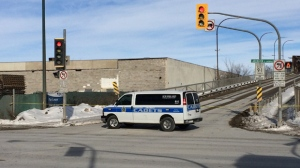 Police cadets block the Arlington Street Bridge after a man was hit by a vehicle Saturday morning.