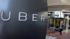 A man leaves the headquarters of Uber in San Francisco on Dec. 16, 2014. (AP / Eric Risberg)