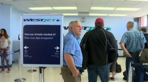 Passengers wait to board a WestJet flight at the Brandon Municipal Airport. (File image)