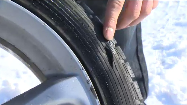 Justin Yakiwchuk shows where one of his tires blew out after he hit a large pothole on Lakewood Boulevard.