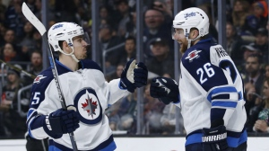 Winnipeg Jets right wing Blake Wheeler, right, celebrates his game-tying goal with teammate center Mark Scheifele, left, against the Los Angeles Kings during the third period of an NHL hockey game, Saturday, April 9, 2016, in Los Angeles. (AP Photo/Danny Moloshok)
