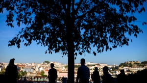 Tourists watch Lisbon's skyline from the shade of a public garden Saturday, Oct. 26 2013. (AP / Armando Franca)