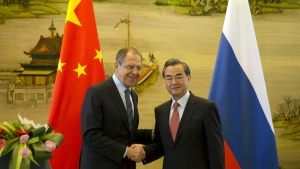 Russian Foreign Minister, Sergey Lavrov, left, and Chinese Foreign Minister Wang Yi shakes hands after a joint press conference held at the Chinese Foreign Ministry in Beijing, China on Friday, April 29, 2016. (AP / Ng Han Guan)