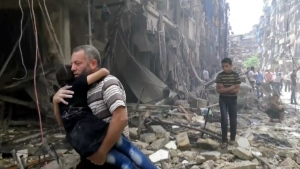 In this image made from video and posted online from Validated UGC, a man carries a child after airstrikes hit Aleppo, Syria on Thursday, April 28, 2016. (Validated UGC)
