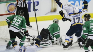 St. Louis Blues centre David Backes starts to celebrates his goal with teammates Jaden Schwartz as Dallas Stars goalie Antti Niemi, Colton Sceviour and Vernon Fiddler look on during overtime of Game 2 of the NHL hockey Stanley Cup Western Conference semifinals in Dallas on Sunday, May 1, 2016. (AP / LM Otero)