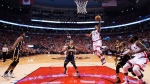 Toronto Raptors guard Kyle Lowry (7) drives the net past Indiana Pacers guard George Hill (3) during second half round one NBA basketball playoff action in Toronto on Sunday, May 1, 2016. THE CANADIAN PRESS/Nathan Denette