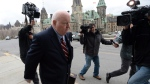 Senator Mike Duffy returned to Parliament Hill in Ottawa Monday and took his seat Tuesday in the Senate for the first time since his suspension. (Sean Kilpatrick / The Canadian Press)