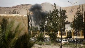Smoke rises above a controlled land mine, which was detonated by Russian experts, in the ancient town of Palmyra in the central Homs province, Syria on Thursday, April 14, 2016. (AP / Hassan Ammar)