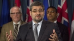 Journalist Mohamed Fahmy and Amnesty International Canada Secretary General Alex Neve listen as Abdullah Almalki speaks during a press conference in Ottawa on Tuesday, May 3, 2016. (Adrian Wyld / THE CANADIAN PRESS)