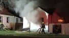 Smoke and flames are seen pouring from a home in the 200 block of Roberta Avenue early Wednesday morning.