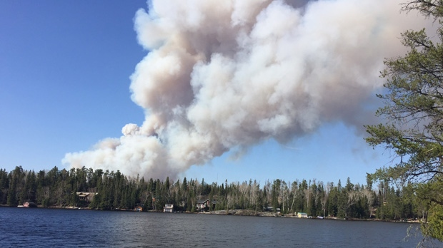 Water bombers from Manitoba and Ontario are fighting a forest fire near the provincial border. CTV viewers in the area submitted photos of thick smoke Thursday evening. The fire is across the border from West Hawk and Caddy Lake. Photo by Ross Reinhardt.