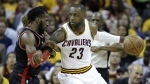 Cleveland Cavaliers' LeBron James looks to pass around Toronto Raptors' DeMarre Carroll during the first half of Game 5 of the NBA basketball Eastern Conference finals in Cleveland on Wednesday, May 25, 2016. (AP / Tony Dejak)