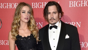 Amber Heard, left, and Johnny Depp arrive at the 27th annual Palm Springs International Film Festival Awards Gala in Palm Springs, Calif. on Jan. 2, 2016. (Jordan Strauss / Invision)