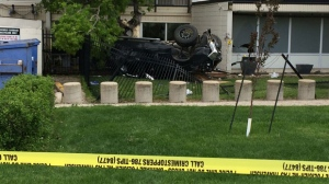 The vehicle remains flipped over hours after the crash, as police continue to investigate.