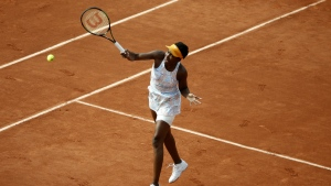Venus Williams of the U.S. returns the ball to France's Alize Cornet during their third round match of the French Open tennis tournament at the Roland Garros stadium in Paris on Saturday, May 28, 2016. (AP / Alastair Grant)
