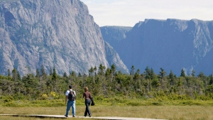 A couple walk along a boardwalk on their way to Western Brook Pond in Gros Morne, N.L., in an August 14, 2007, file photo. THE CANADIAN PRESS/Jonathan Hayward, File